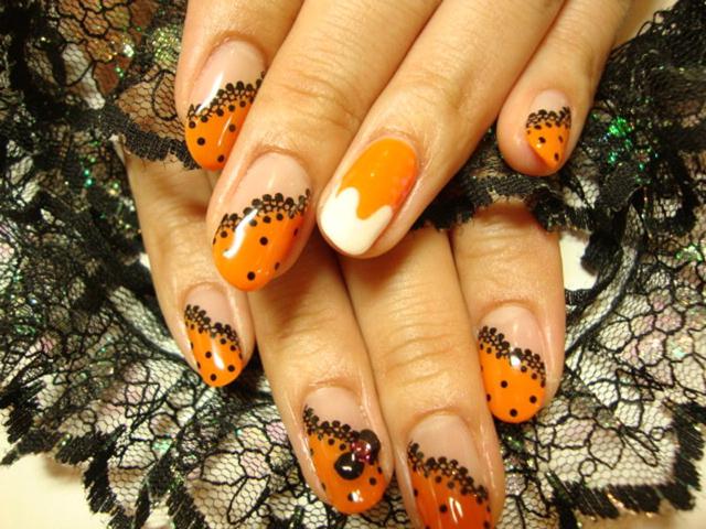 オレンジと黒で華やかで秋らしいレーシーネイル☆